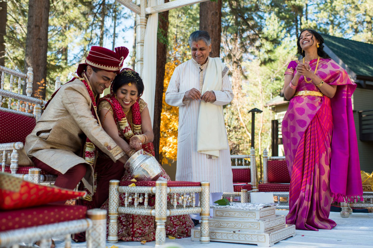 Lake Tahoe Indian wedding couple reaches in pot