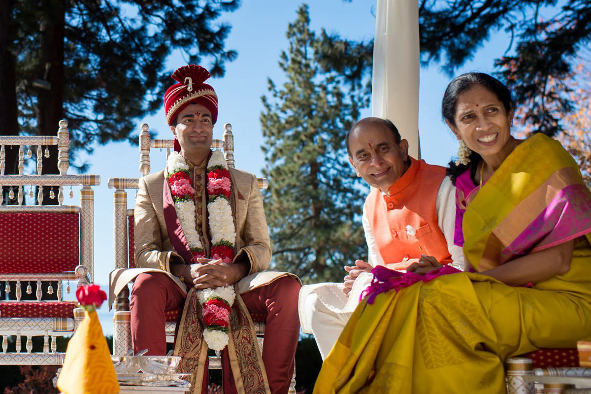 Lake Tahoe Indian wedding groom awaiting bride on mandap