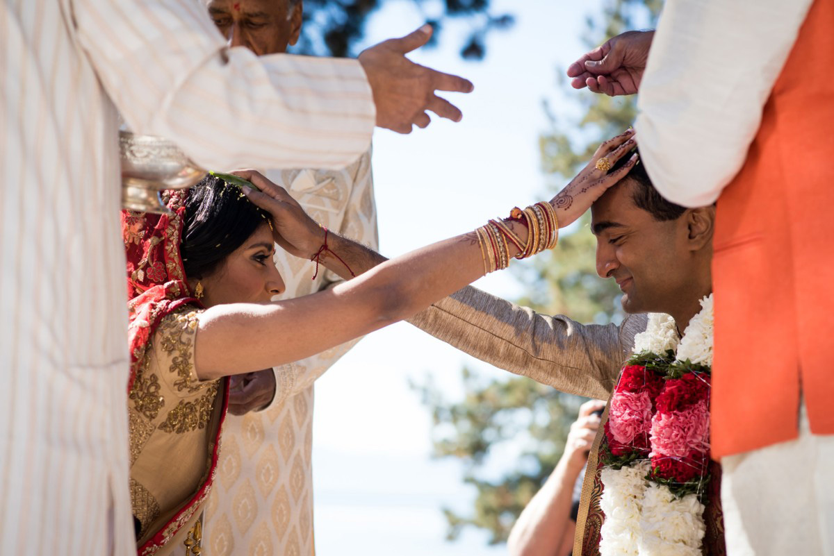 Lake Tahoe Indian wedding bride and groom hands on heads