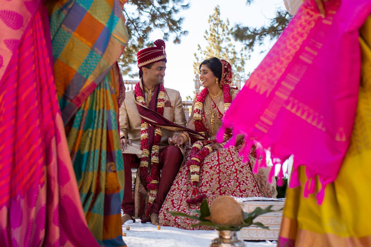 Lake Tahoe Indian wedding bride and groom sitting on mandap