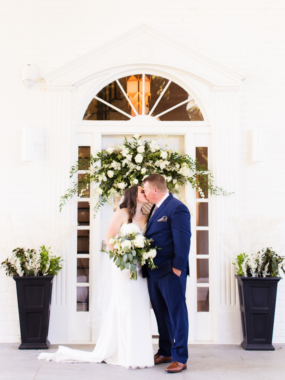 B&B Photography Lake Tahoe wedding - couple kissing by doorway