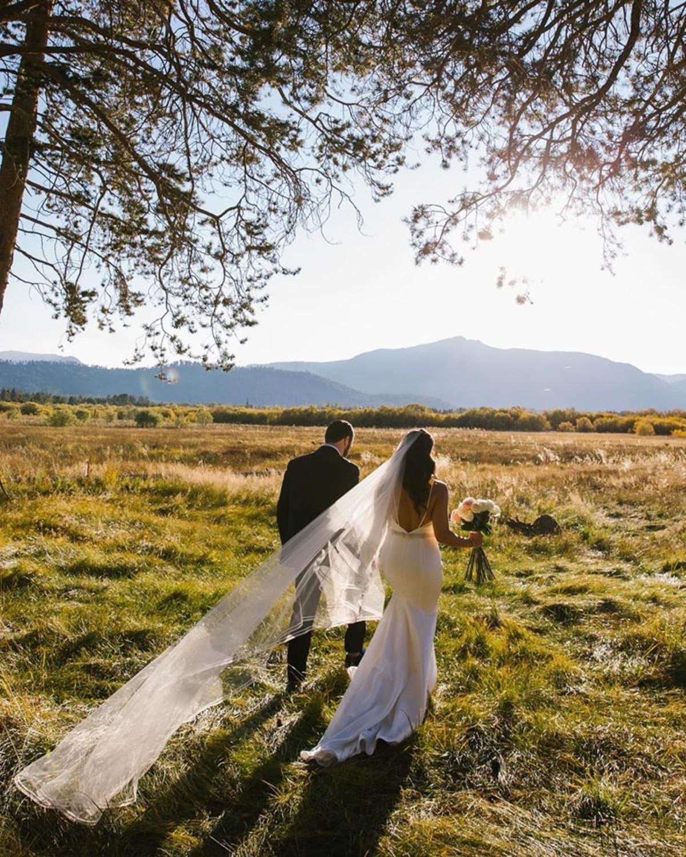 Beau & Arrow Event Co. - Lake Tahoe Wedding Planner - couple walking in field