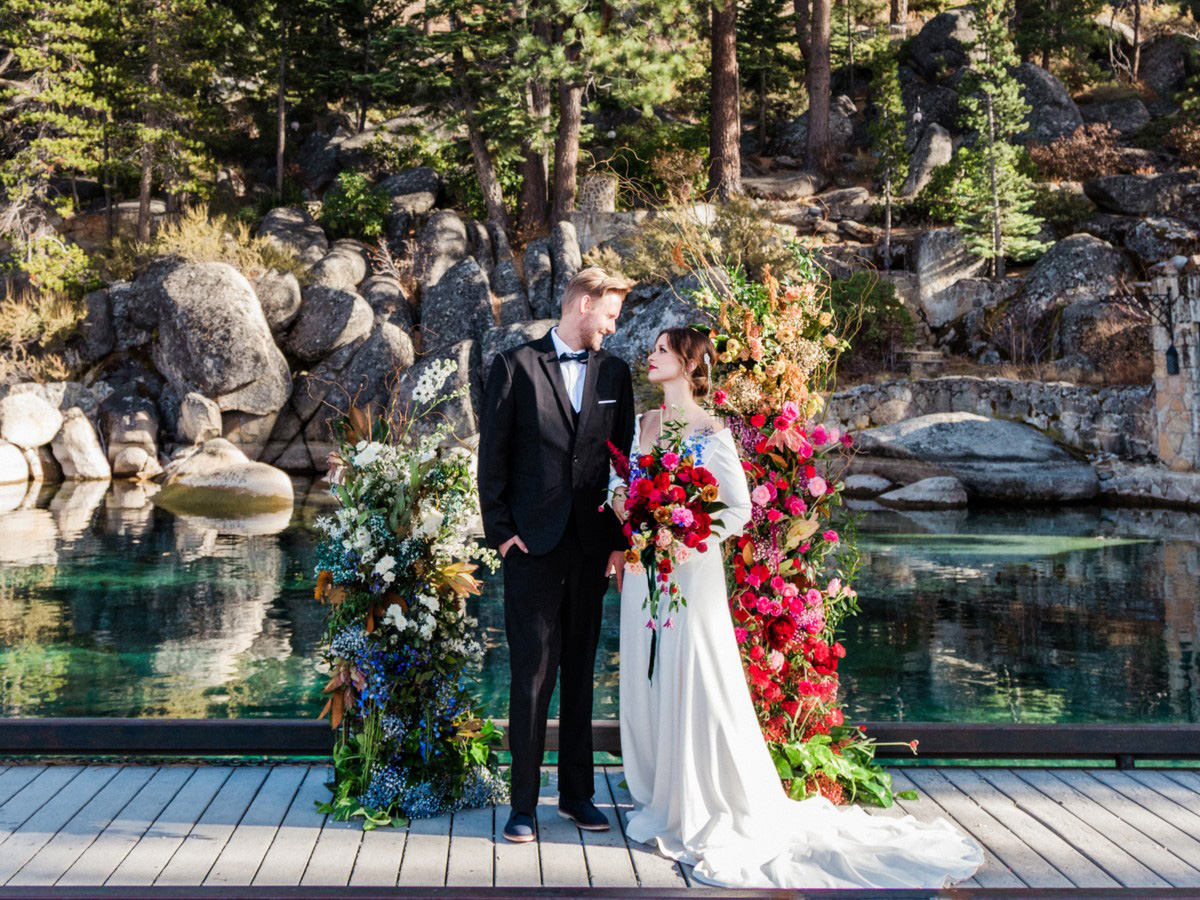 Thunderbird Lake Tahoe wedding styled shoot - couple by ceremony flowers