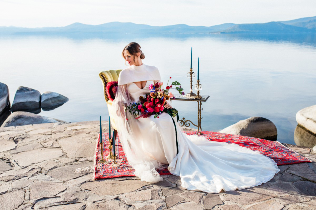 Thunderbird Lake Tahoe wedding styled shoot - bride sitting in chair by lake