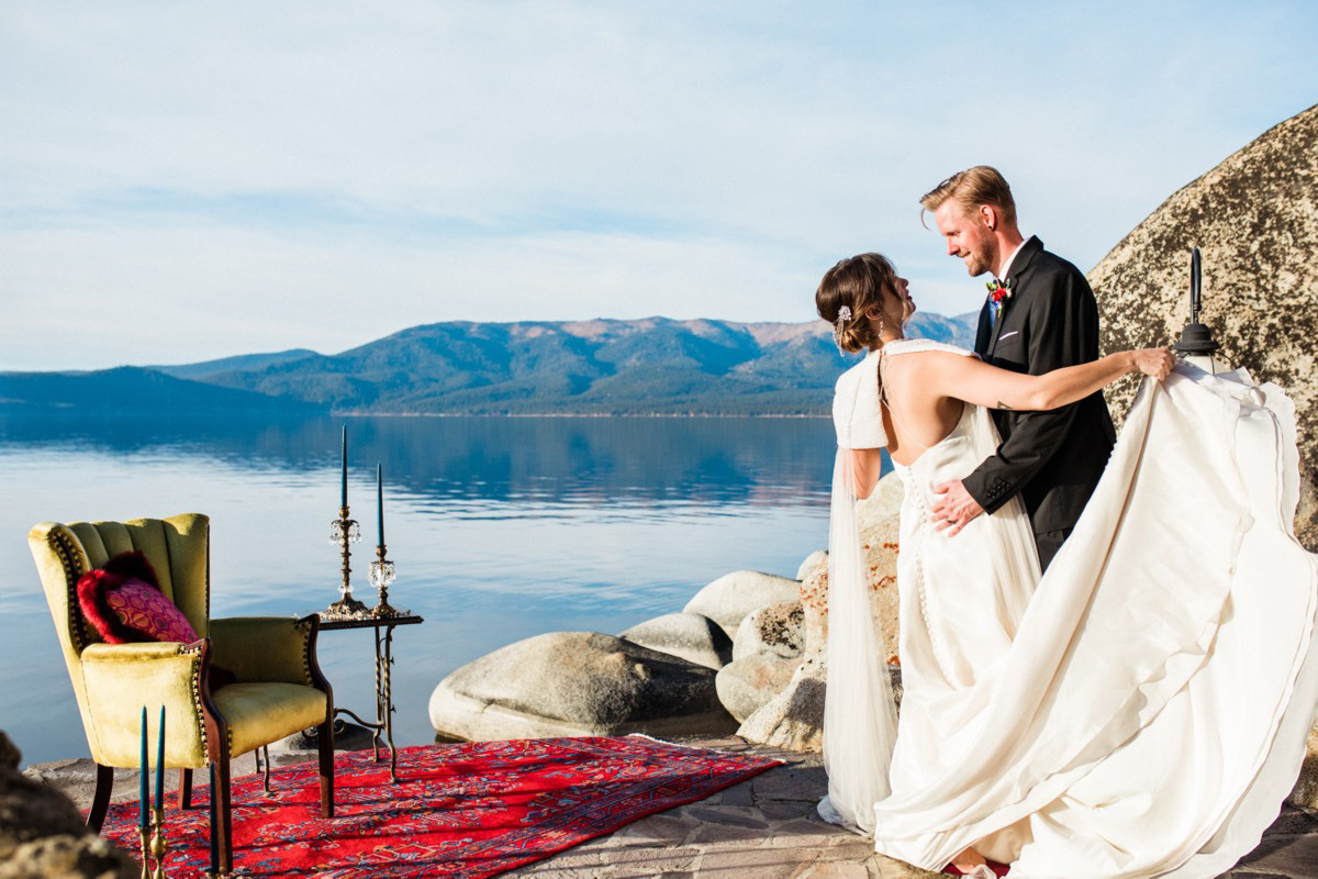 Thunderbird Lake Tahoe wedding styled shoot - couple embracing by lake and furniture