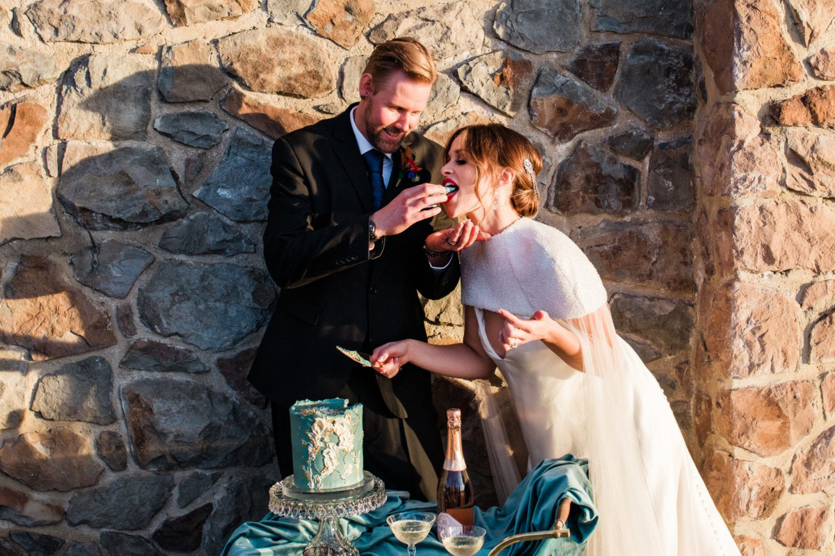 Thunderbird Lake Tahoe wedding styled shoot - groom feeding cake to bride