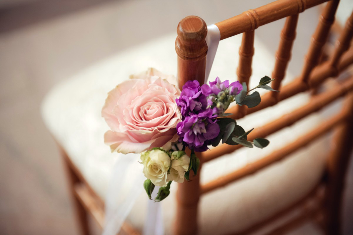 Inspirations by Gina - Lake Tahoe florist - ceremony chair treatment