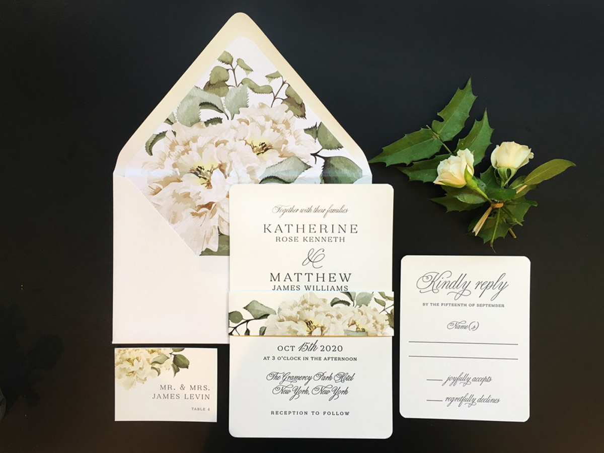 wedding invitation with reply card escort card and white roses
