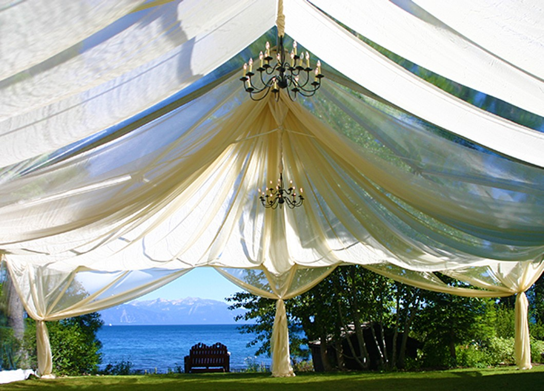 tent with chandelier Lake Tahoe wedding furniture