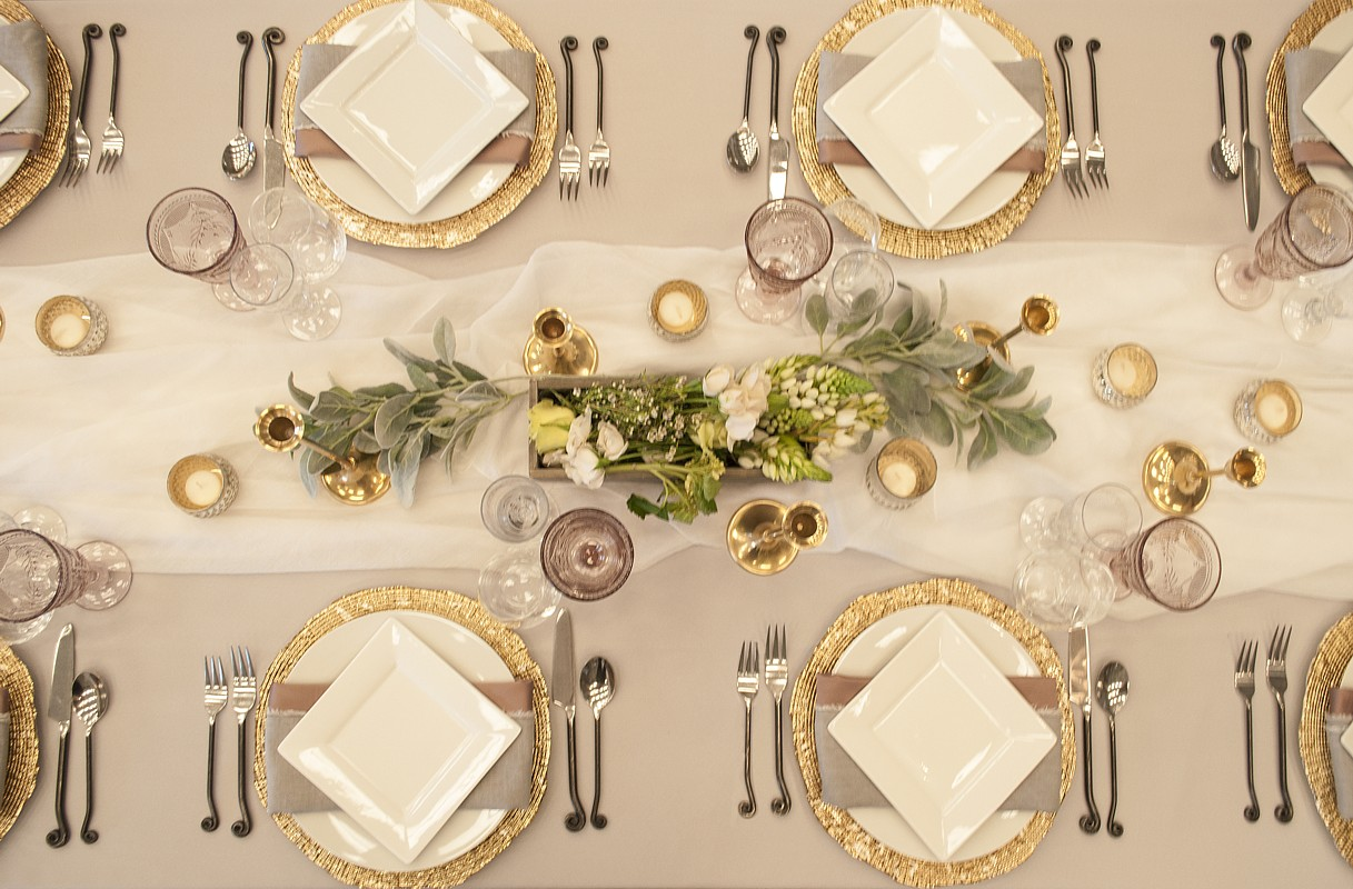 table setting with layered-linens celebrations party rentals Lake Tahoe wedding