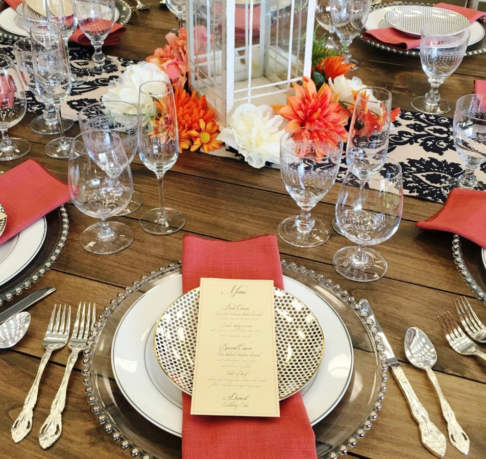 place setting orange napkins celebrations party rentals Lake Tahoe wedding