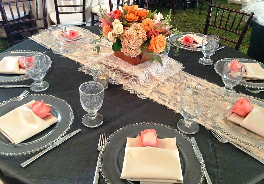 table setting with napkins chargers celebrations party rentals wedding