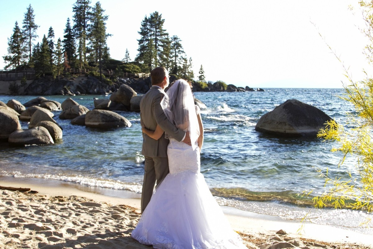 couple on beach Lake Tahoe wedding officiant Ceremony of Love