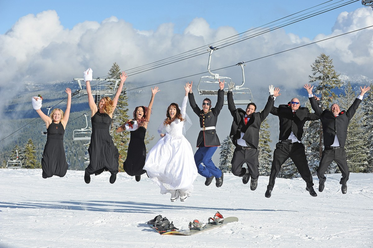 wedding party jumping in snow Lake Tahoe officiant Ceremony of Love