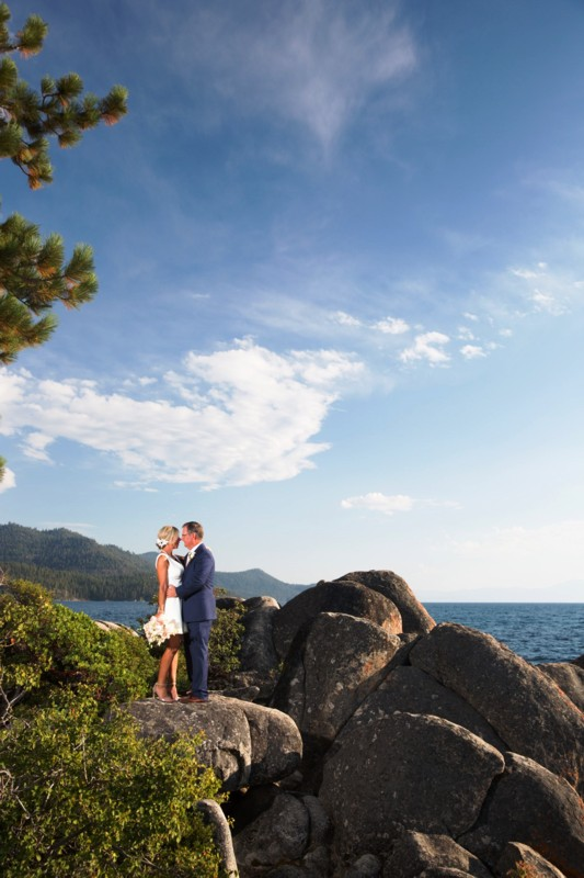 couple standing on rocks Lake Tahoe wedding planner Ceremony of Love