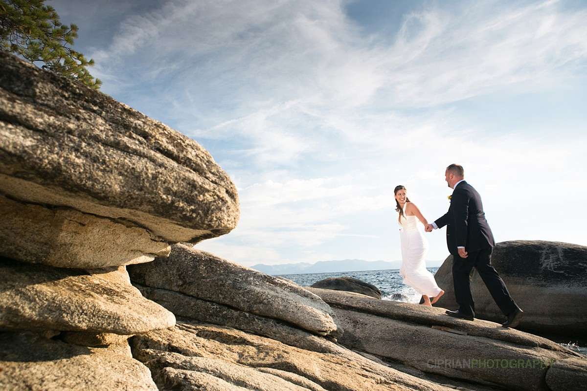 couple on rocks Lake Tahoe wedding planner Ceremony of Love