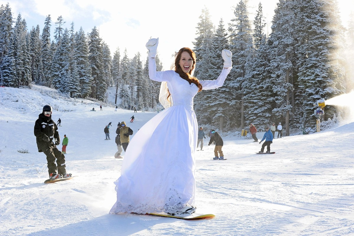 bride on snowboard Lake Tahoe wedding planner Ceremony of Love