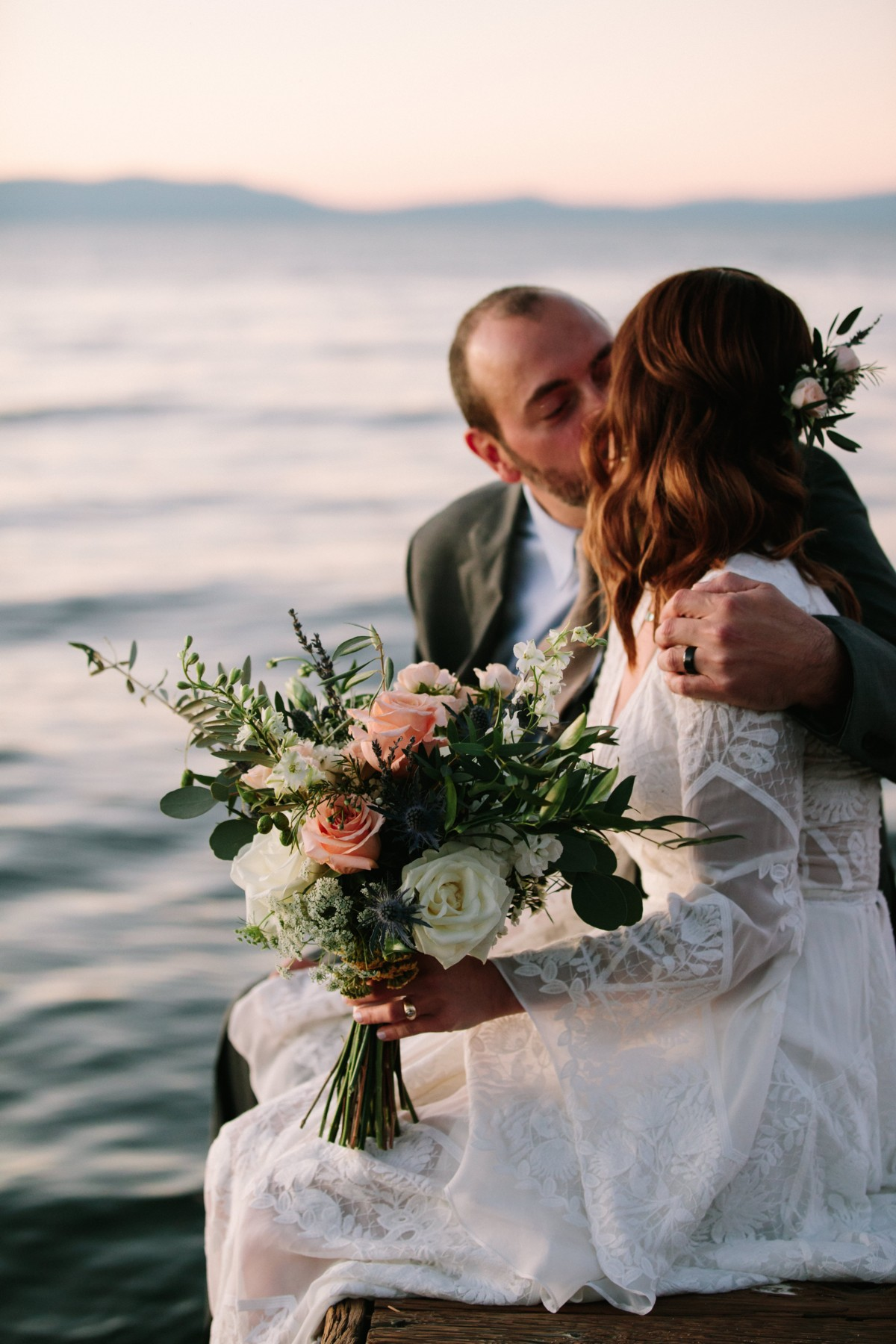 Lake Tahoe wedding florist Create With T - couple by lake with bouquet