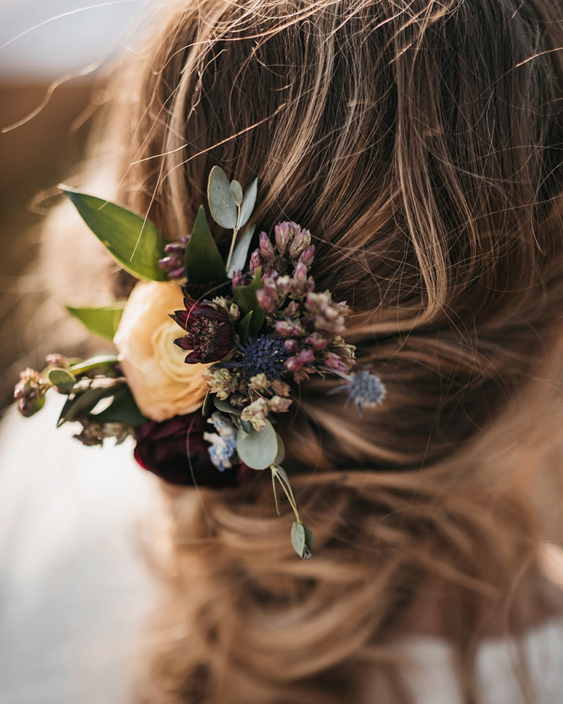 Lake Tahoe Elopement - bride's hair style and florals