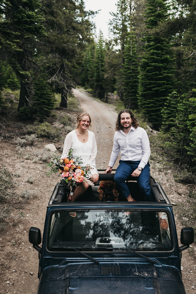 Lake Tahoe Elopement - couple sitting on top of Jeep