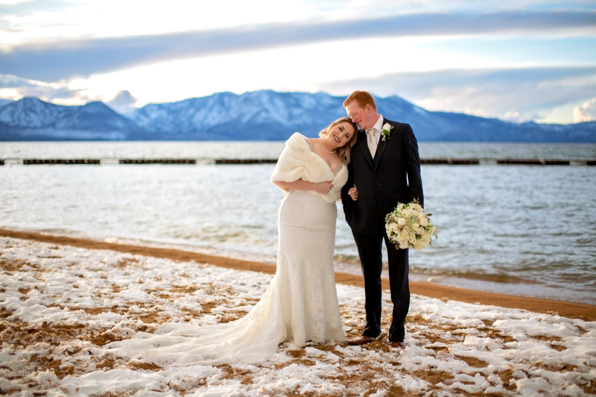 Lake Tahoe wedding Forest Suites Resort - couple on snowy beach