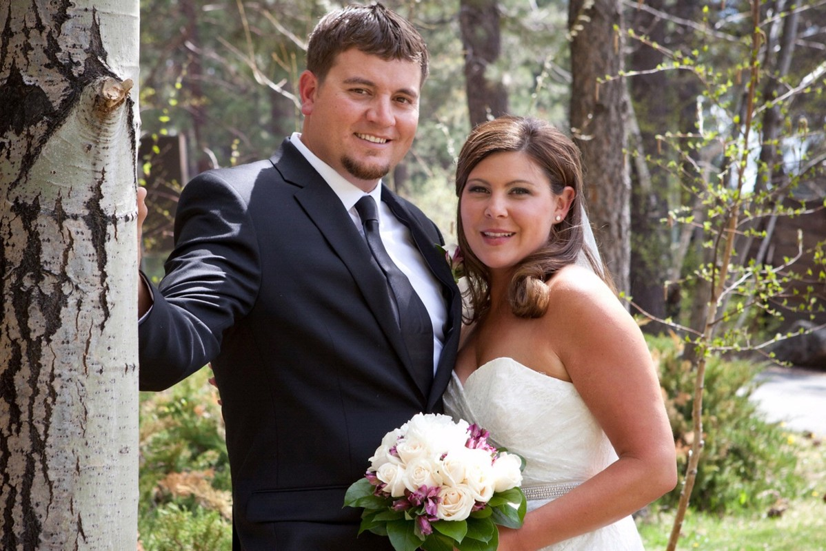 Lake Tahoe wedding Forest Suites Resort - happy couple in wooded area
