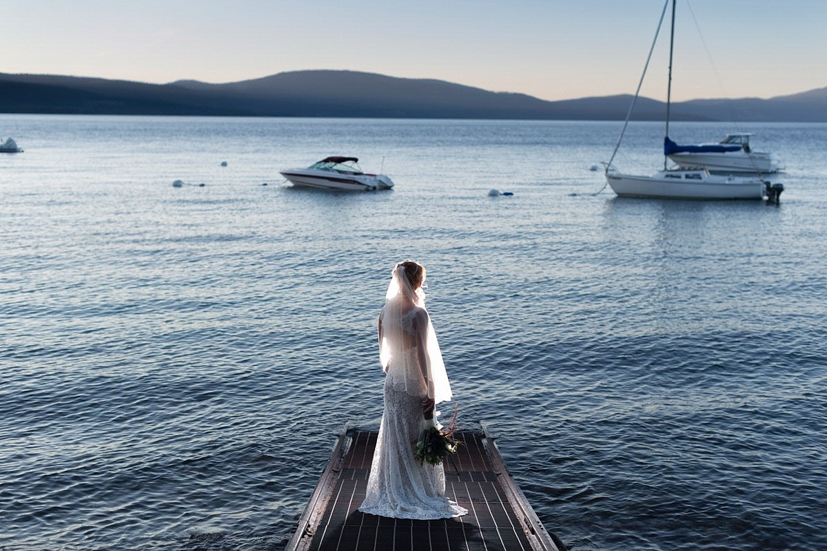 Lake Tahoe wedding Forest Suites Resort - bride on pier