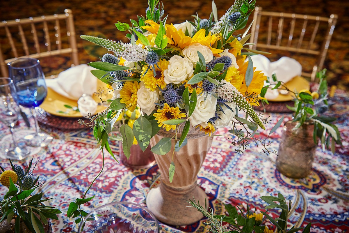 Inspirations by Gina - Lake Tahoe wedding florist - colorful centerpiece and linen