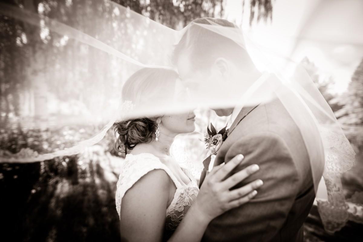 Jeramie Lu Photography - Lake Tahoe wedding couple under bride's veil