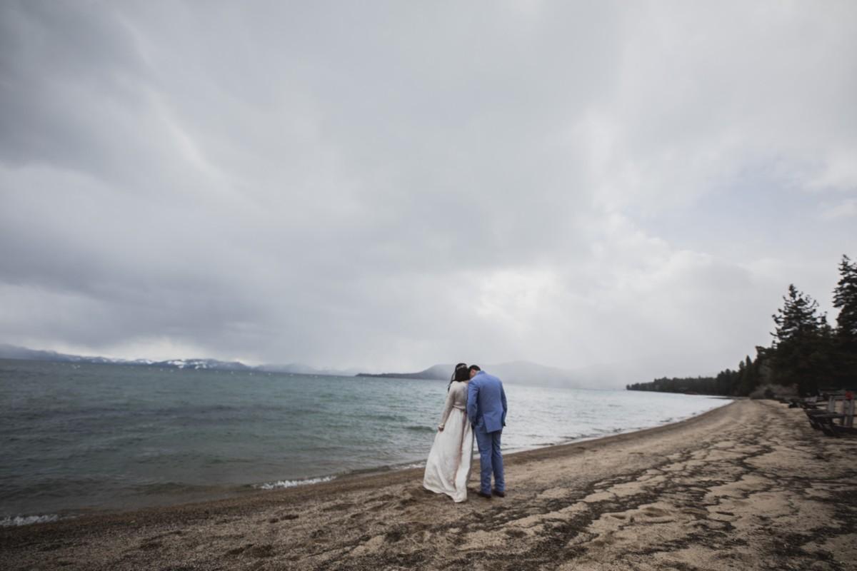 Jeramie Lu Photography - Lake Tahoe wedding couple walking along shoreline