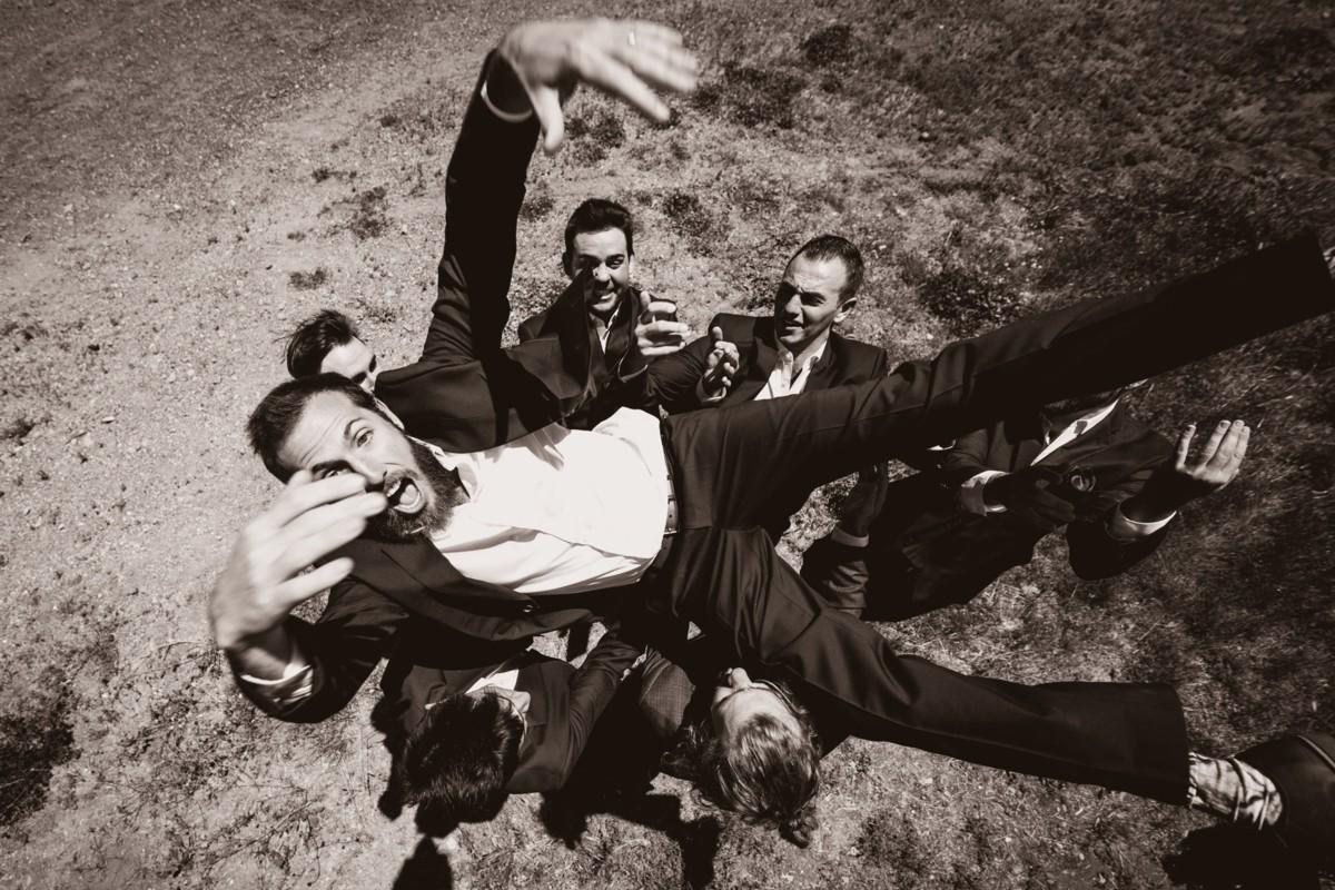 Jeramie Lu Photography - groomsmen throwing groom in the air