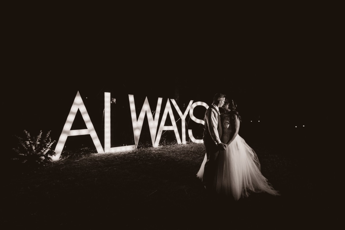 Jeramie Lu Photography - Lake Tahoe wedding couple by lighted sign
