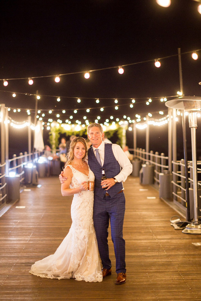 Blue Sky Events Lake Tahoe wedding - happy couple on pier at night