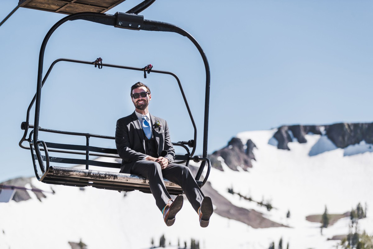 Blue Sky Events Lake Tahoe wedding - groom on ski lift chair