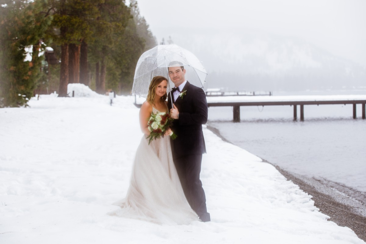 Marcella Camille Events - Lake Tahoe wedding planner - couple by lake in winter