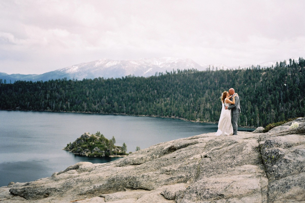 Marcella Camille Events - Lake Tahoe wedding planner - couple on rocks overlooking Emerald Bay