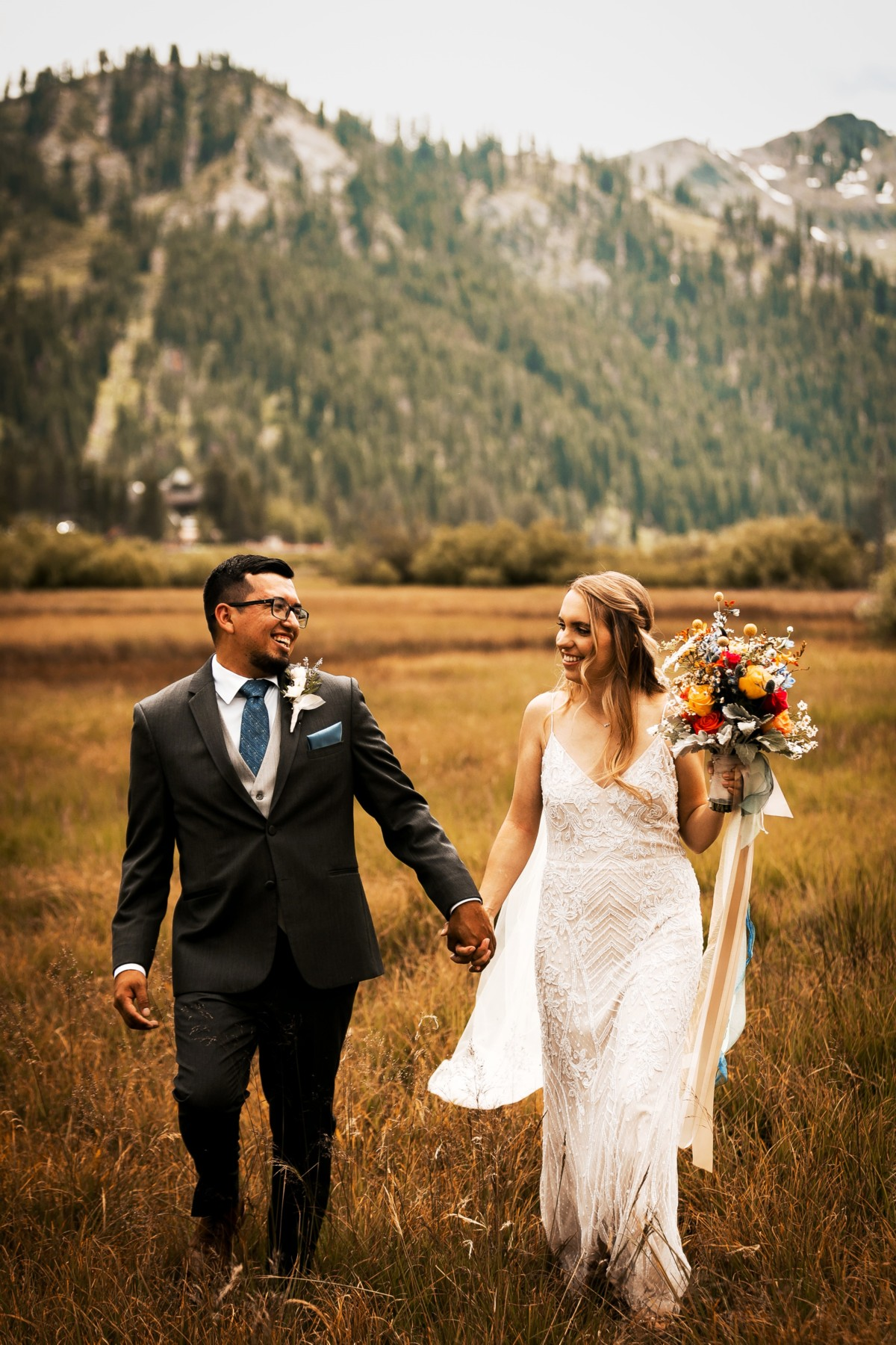 Marcella Camille Events - Lake Tahoe wedding planner - couple in field by mountains
