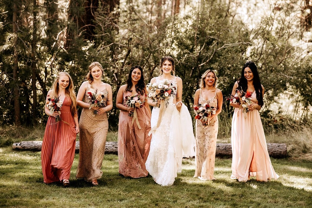 Nancy Rice Artistry - Lake Tahoe wedding hair & makeup - bride with bridesmaids on lawn