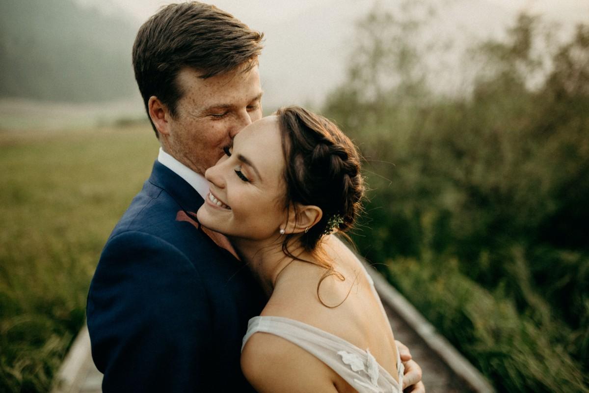 Nancy Rice Artistry - Lake Tahoe wedding hair & makeup - couple embracing in valley