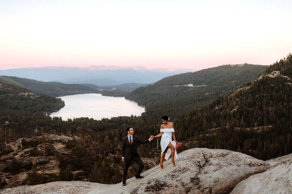Nancy Rice Artistry - Lake Tahoe wedding hair & makeup - couple walking above Donner Lake