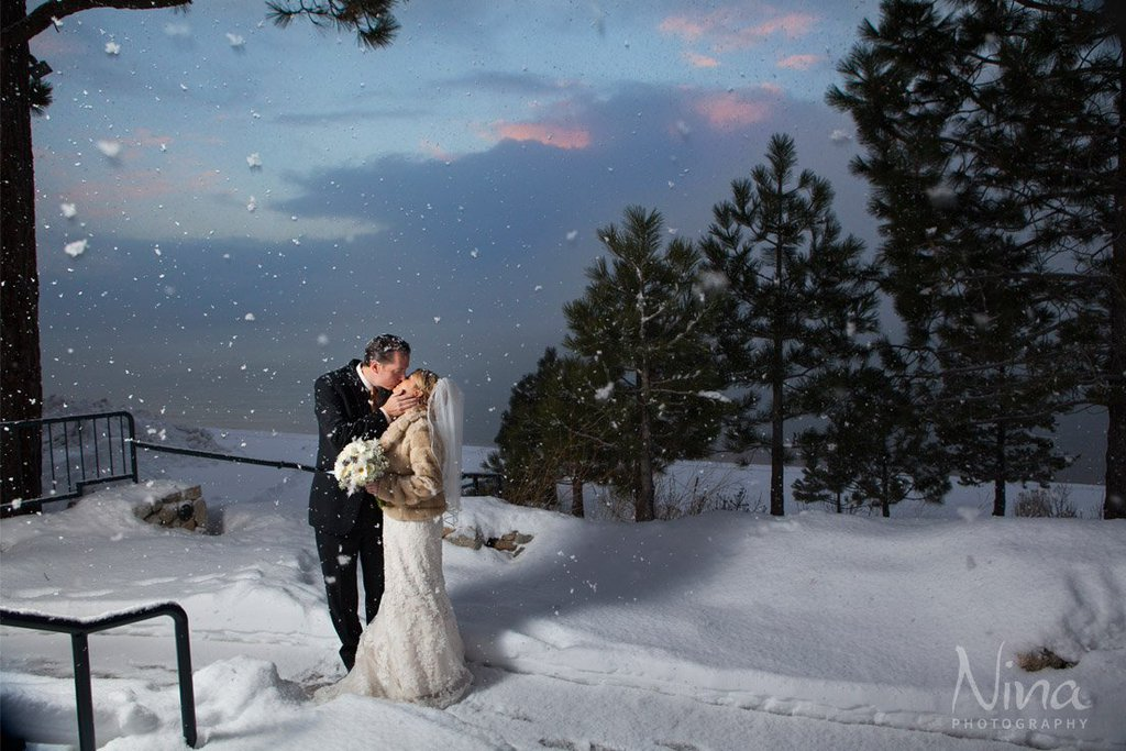 Couple kissing in snow Lake Tahoe winter wedding