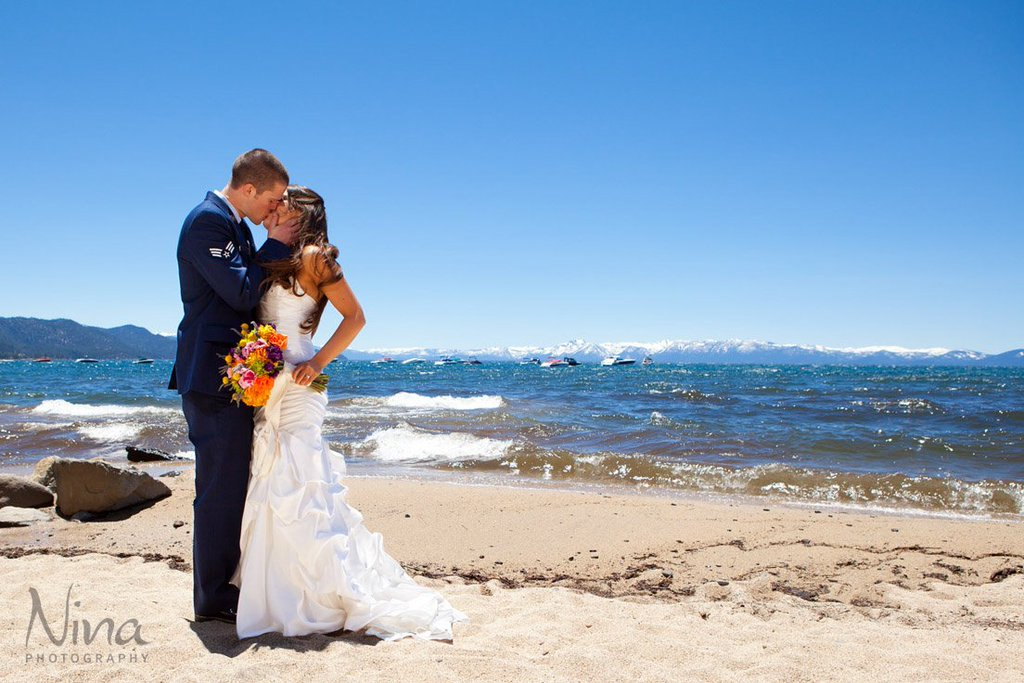 Couple kissing on Lake Tahoe beach wedding
