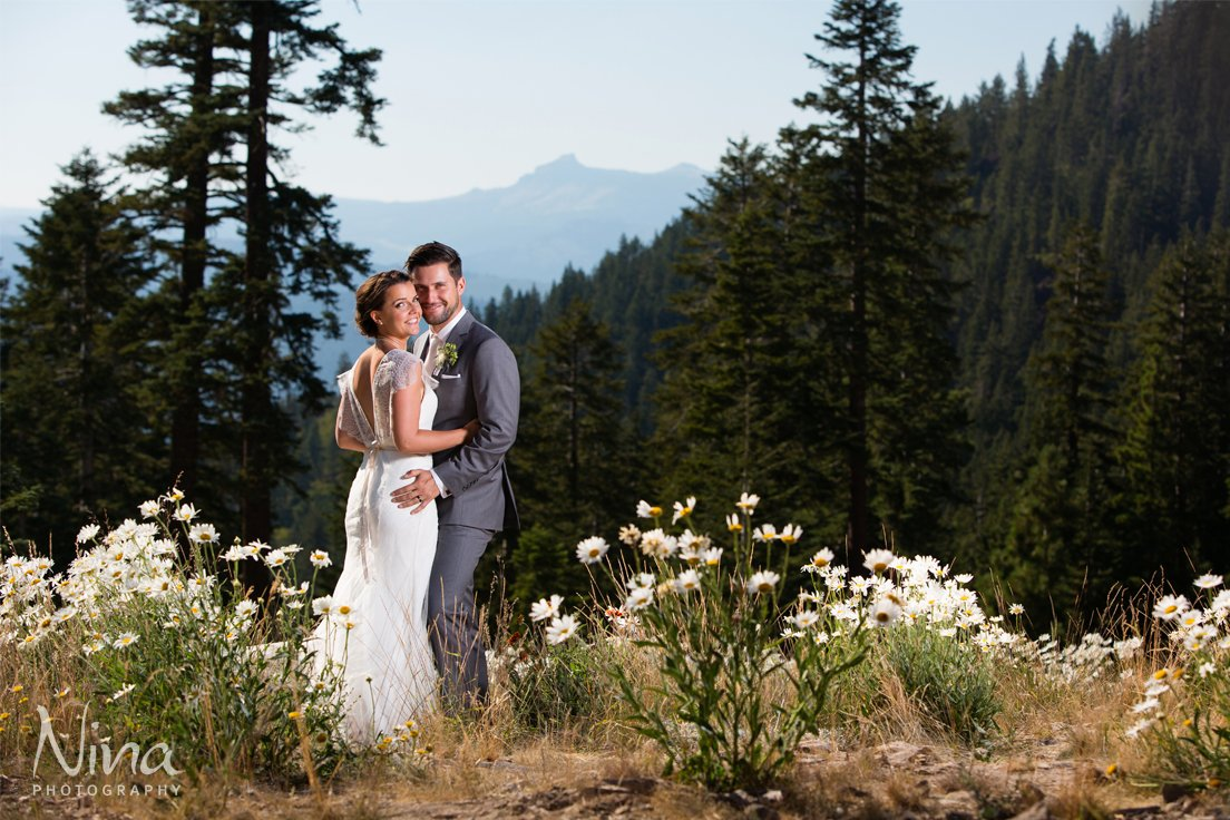 couple with mountain scenery wildflowers Lake Tahoe wedding