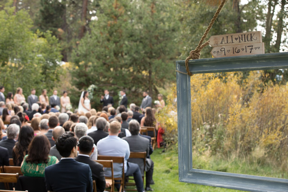 Truckee River Lake Tahoe wedding ceremony with picture frame decor