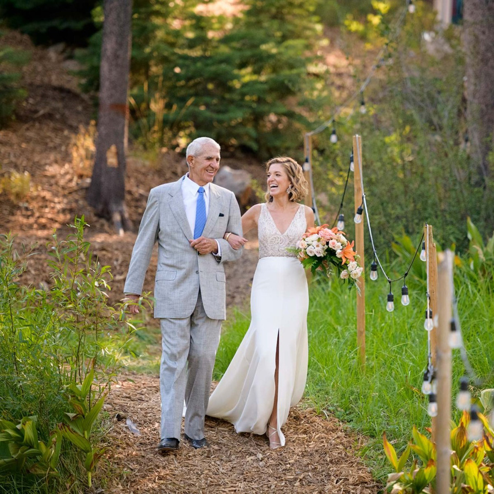 Lake Tahoe wedding on Truckee River - bride down aisle with father