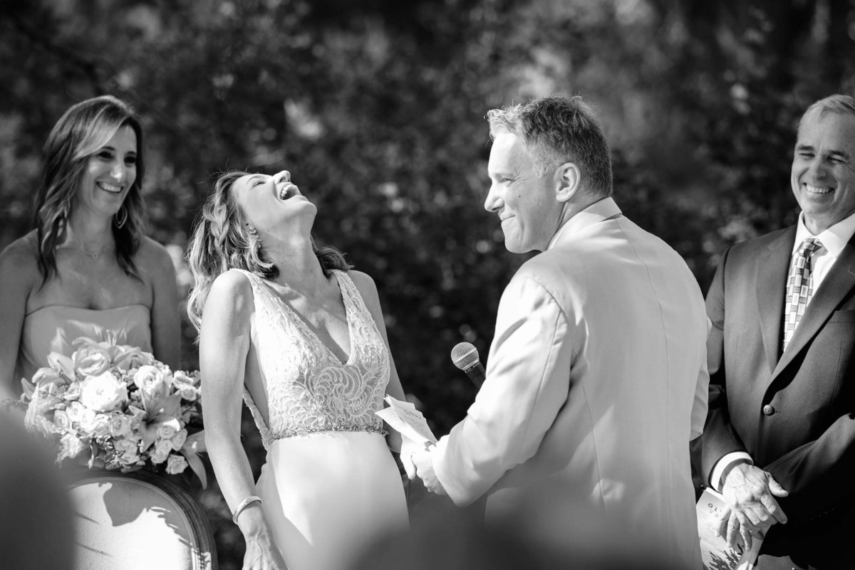 Lake Tahoe wedding on Truckee River - groom reads vows