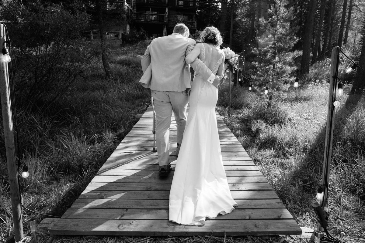 Lake Tahoe wedding on Truckee River - bride and groom leaving ceremony