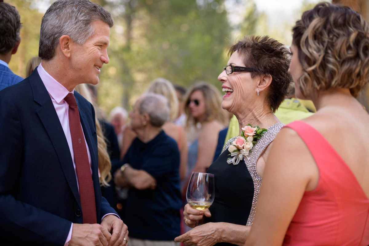 Lake Tahoe wedding on Truckee River - guests at cocktail reception