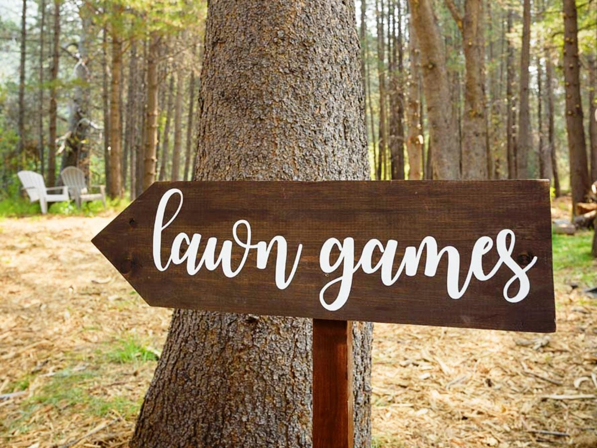 Lake Tahoe wedding on Truckee River - sign for games at river