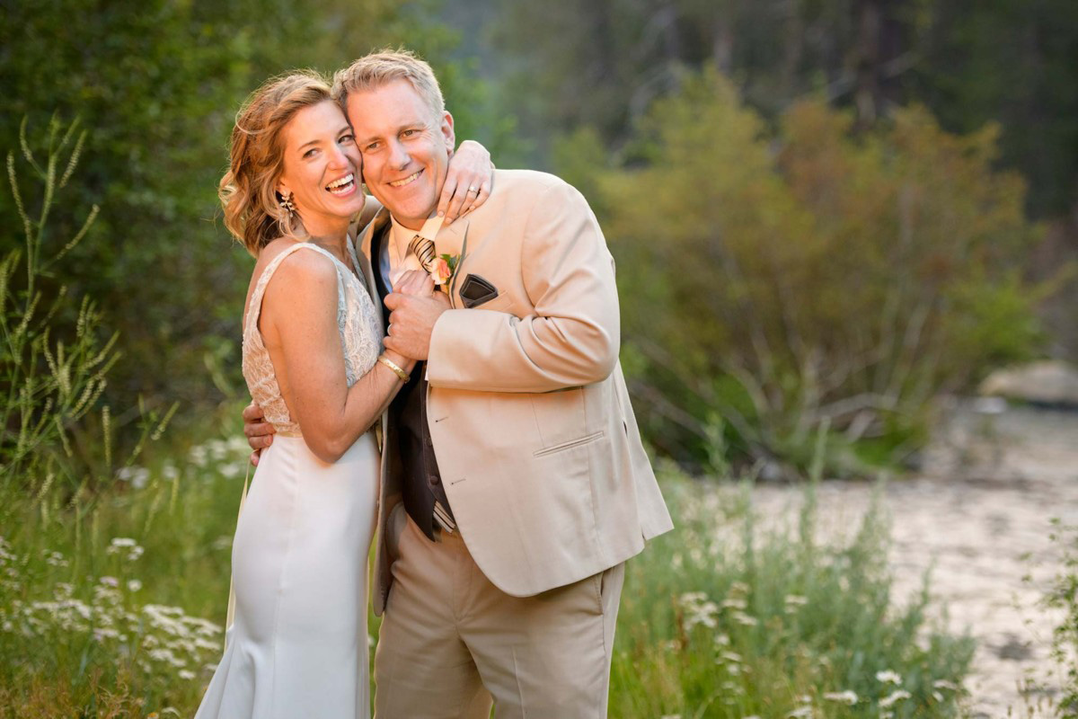 Lake Tahoe wedding on Truckee River - couple posing by river